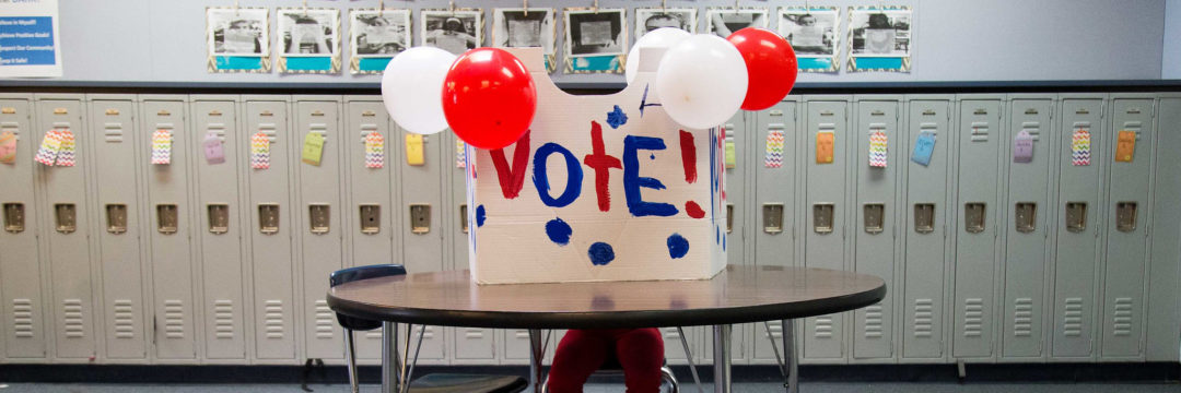 student votes in mock election booth